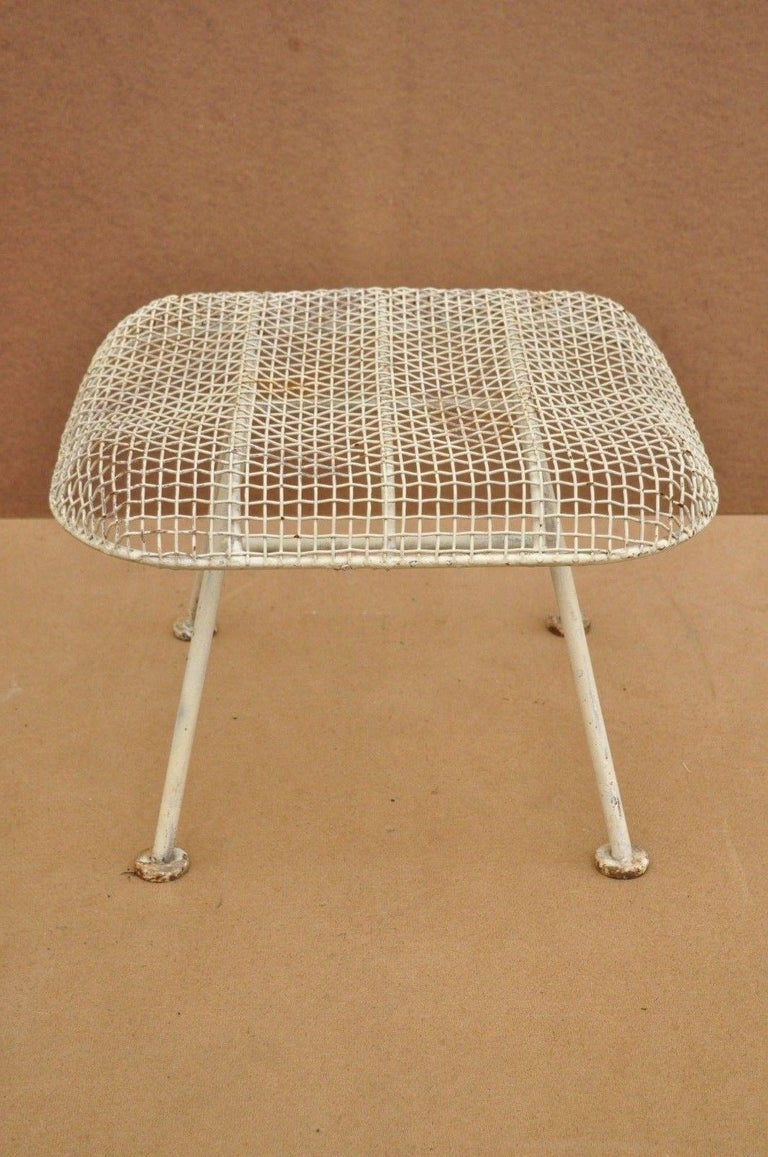 Vintage Russell Woodard Sculptura metal mesh wrought iron ottoman footstool. Item features iron frame, metal mesh seats, iconic Mid-Century Modern design, very nice vintage item, circa 1950. Measurements: 14
