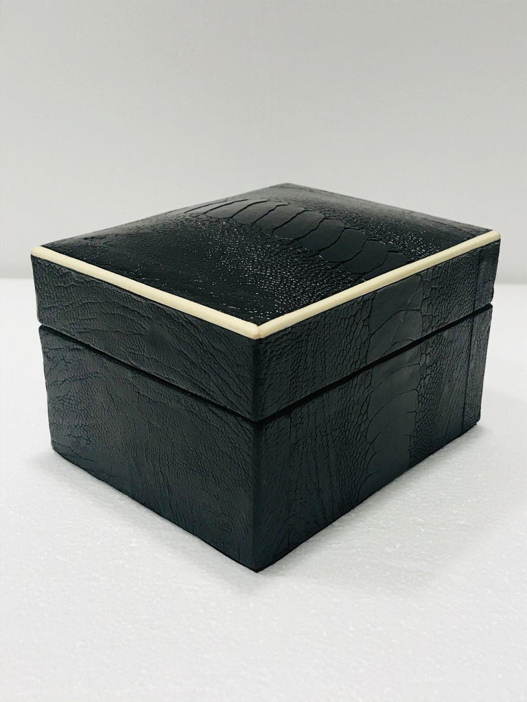 Organic modern decorative box wrapped in exotic ostrich leather with bone inlay detail. All handcrafted in hand-dyed black leather with palmwood interior. Great desk or coffee table accessory. Signed R&Y Augousti on the underside. Box also available