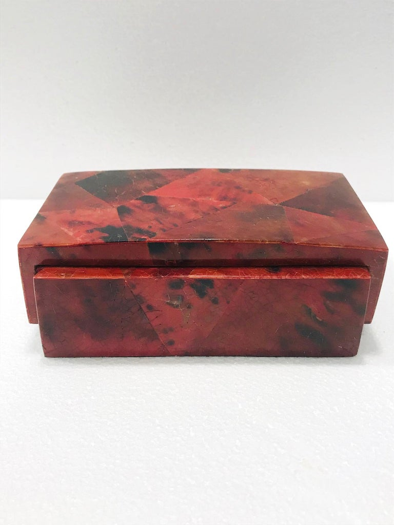 Organic modern desk accessory, lidded box, or jewelry box by R&Y Augousti. All handcrafted in exotic materials featuring lacquered and hand dyed pen-shell over a wood frame. The box features mosaic shell inlays in beautiful hues of red and black.