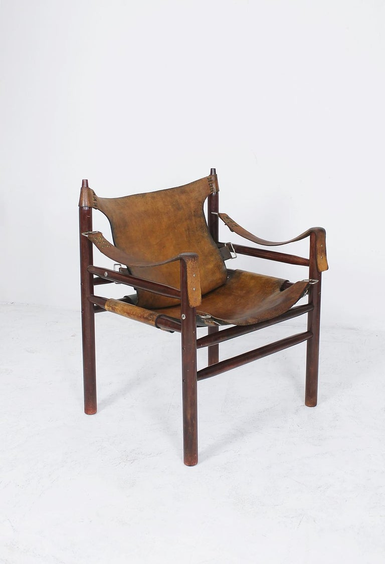 Original and unique vintage Safari chair in the manner of Swedish furniture designer, Arne Norell, from the same period, it was manufactured, circa 1970s in Hungary.