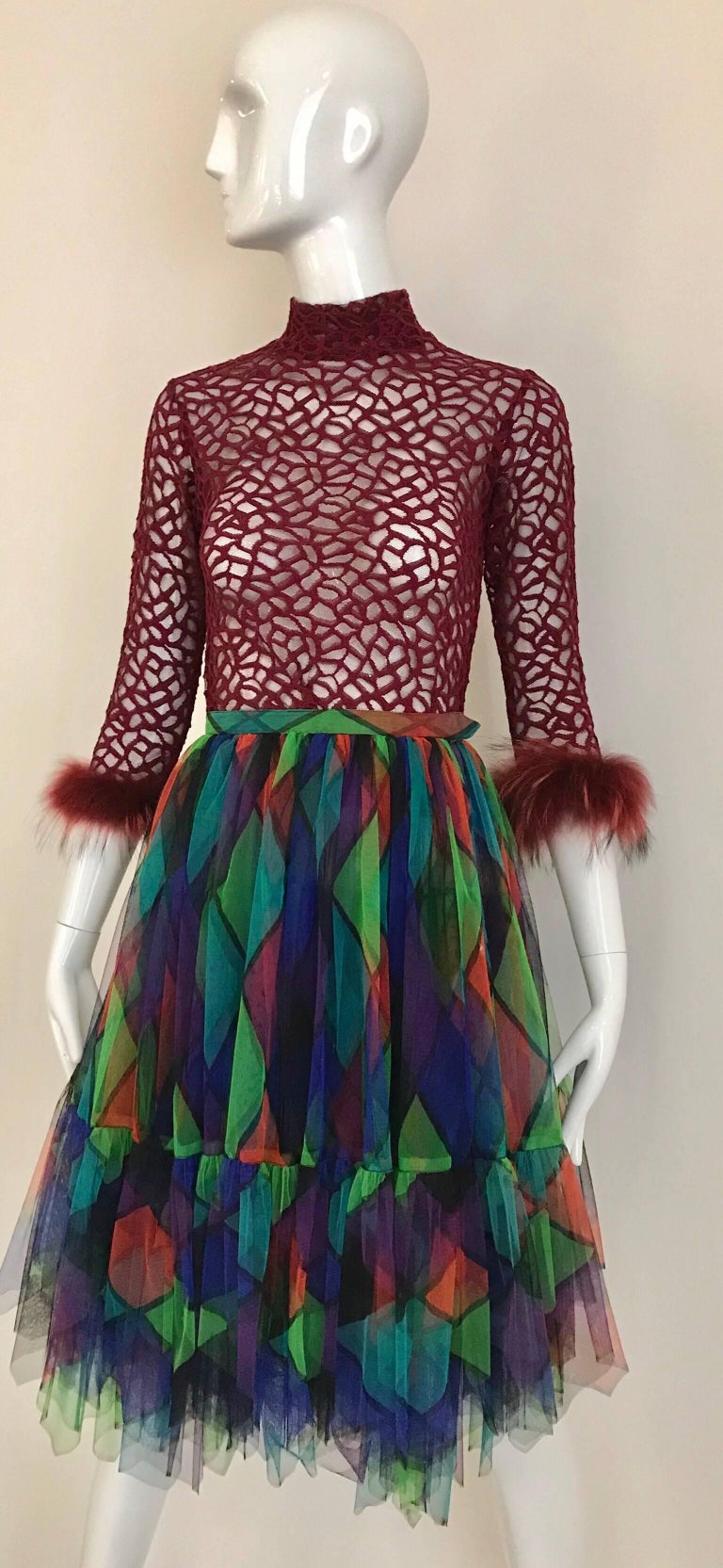 1980s Red, black, green and teal print harlequin tulle mini skirt.  Skirt is paired with Jean Paul Gaultier burgundy mesh cropped sweater shirt with ostrich sleeves. (  sweater shirt available for purchase)  Waist; 24 inches/ skirt length : 26