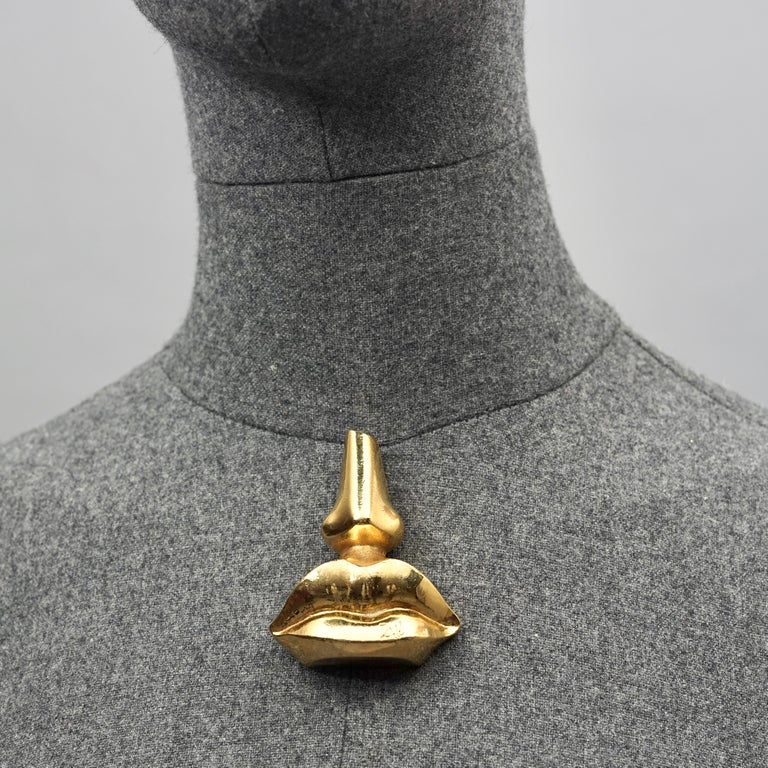 Vintage SALVADOR DALI Iconic Nose Lips Novelty Massive Brooch  Measurements: Height: 2.55 inches (6.5 cm) Width: 1.96 inches (5 cm)  Features: - 100% Authentic SALVADOR DALI. - Iconic nose and lips brooch from