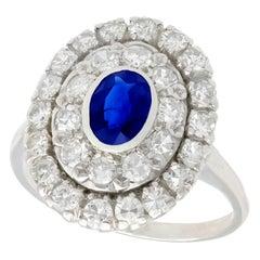 1940s Sapphire and 1.88 Carat Diamond Platinum Cluster Ring