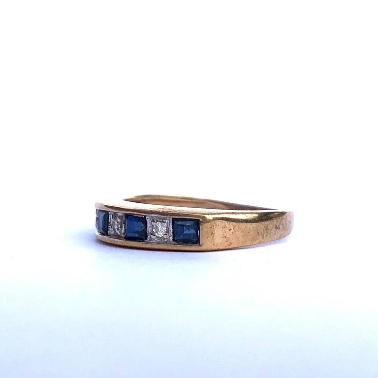 Holding five Sapphires and four Diamonds, this half eternity band is fabulous! The sapphires measure 10pts each and the diamonds are small but still have a wonderful sparkle. The stones are set in platinum and the band is modelled in 9ct gold.  Ring