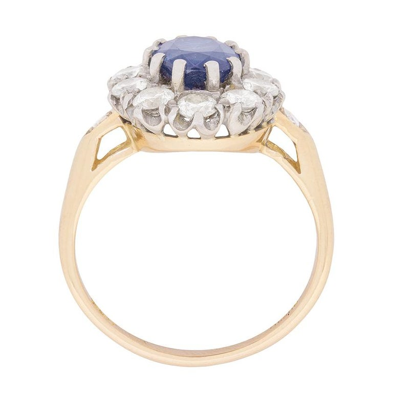 In the centre of this vintage ring is a 1.50 carat sapphire. It is a stunning blue in colour and has been claw set perfectly. To enhance the colour and add some sparkle to this ring, there is a beautiful halo of diamonds which total 1.00 carat. They