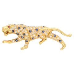 Vintage Sapphire and Diamond Panther Brooch Set in 18k Yellow Gold