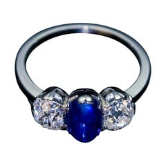 Vintage Sapphire Diamond Three-Stone Platinum Engagement Ring