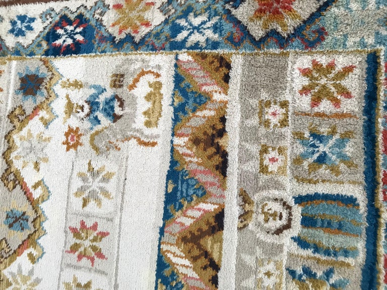 Nice Scandinavian rug with a beautiful design and colors with blue, yellow and orange, entirely hand knotted with wool velvet on cotton foundation.