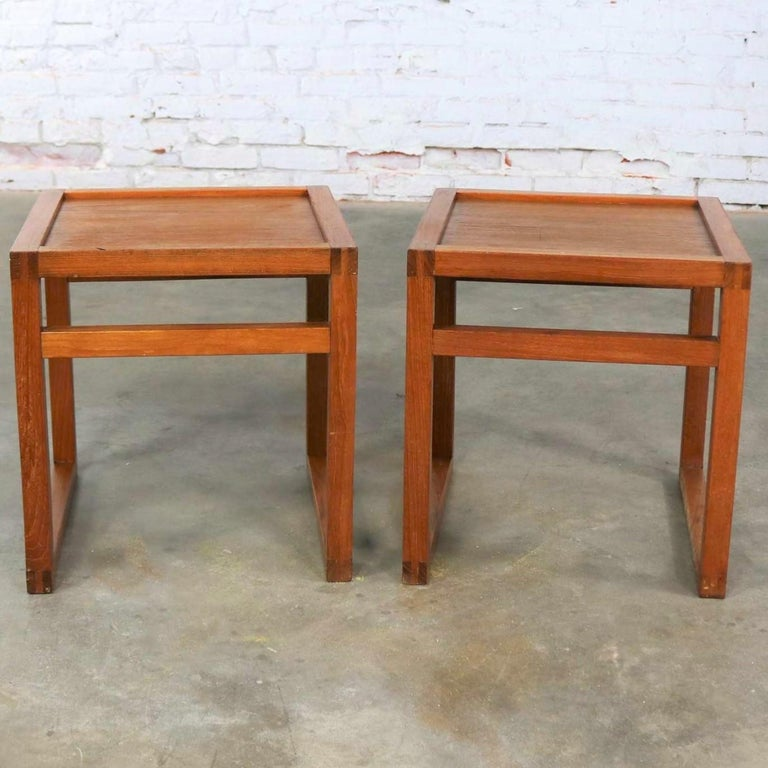 Handsome pair of Scandinavian Modern square side tables in teak with an open cube styling. They are in wonderful vintage condition with no outstanding flaws. Please see photos. Price is for the pair, circa 1960s.  Sometimes you just need little
