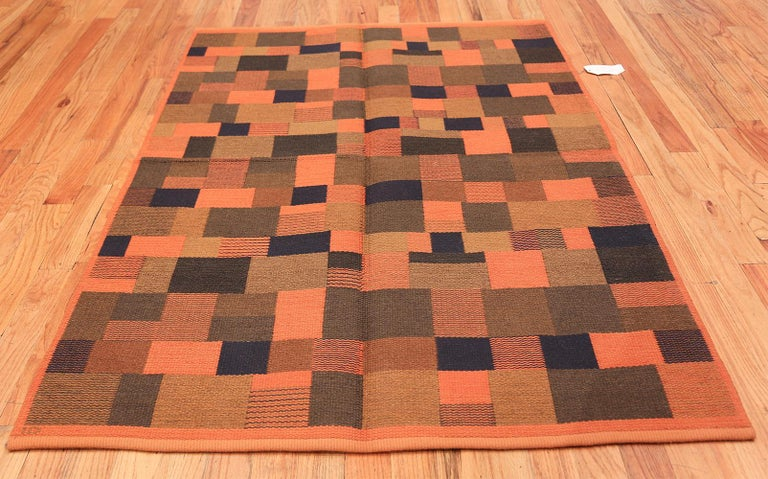 This expressive vintage flat-weave carpet from Sweden represents the daring side of mid-century design. The abstract composition is built around tantalizing op-art motifs, shocking colors and bold geometric shapes that are juxtaposed expertly in a