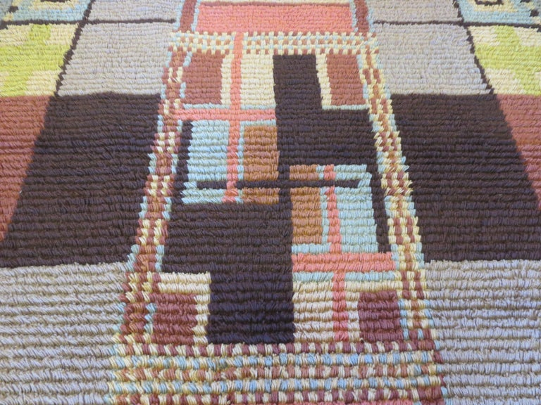 This is a vintage Scandinavian shag rug from the 1930s. It is truly a unique piece signed by the designer and dated 1931. It features skillfully arranged color blocks, with smaller compartments, and rectilinear figures. At its center, it invites the