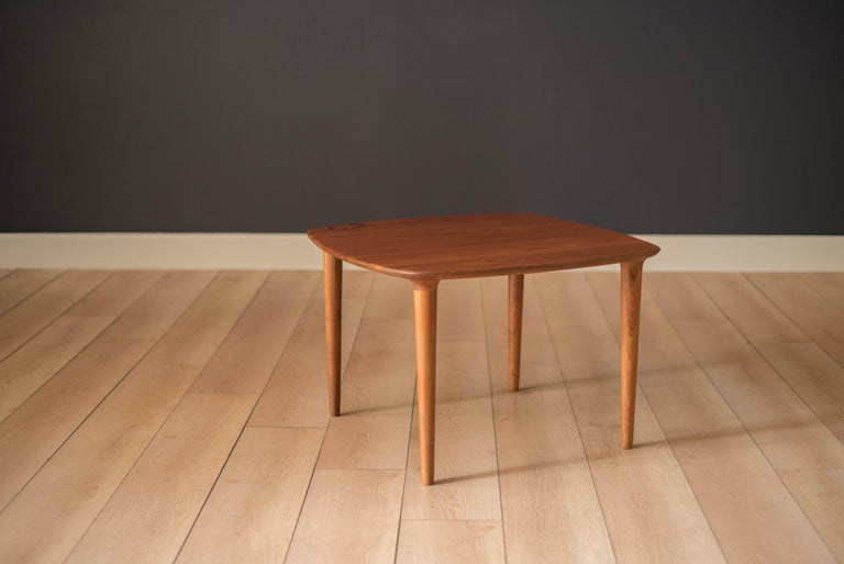 Mid-Century Modern side table manufactured by Gustav Bahus, Norway. This piece is constructed of solid planked teak featuring rounded edges and sculpted legs. Perfect to use as an end table or coffee table.