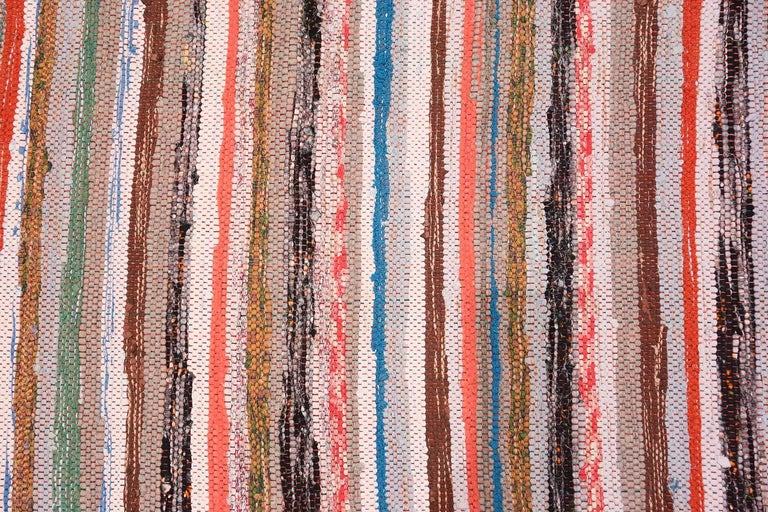 Vintage Scandinavian Swedish rag Runner rug, country of origin: Sweden, date circa mid-20th century - Size: 2 ft. x 6 ft. 3 in (0.61 m x 1.9 m). Bold color, rich warmth and a striking horizontal pattern define this charming rug. Designed and crafted