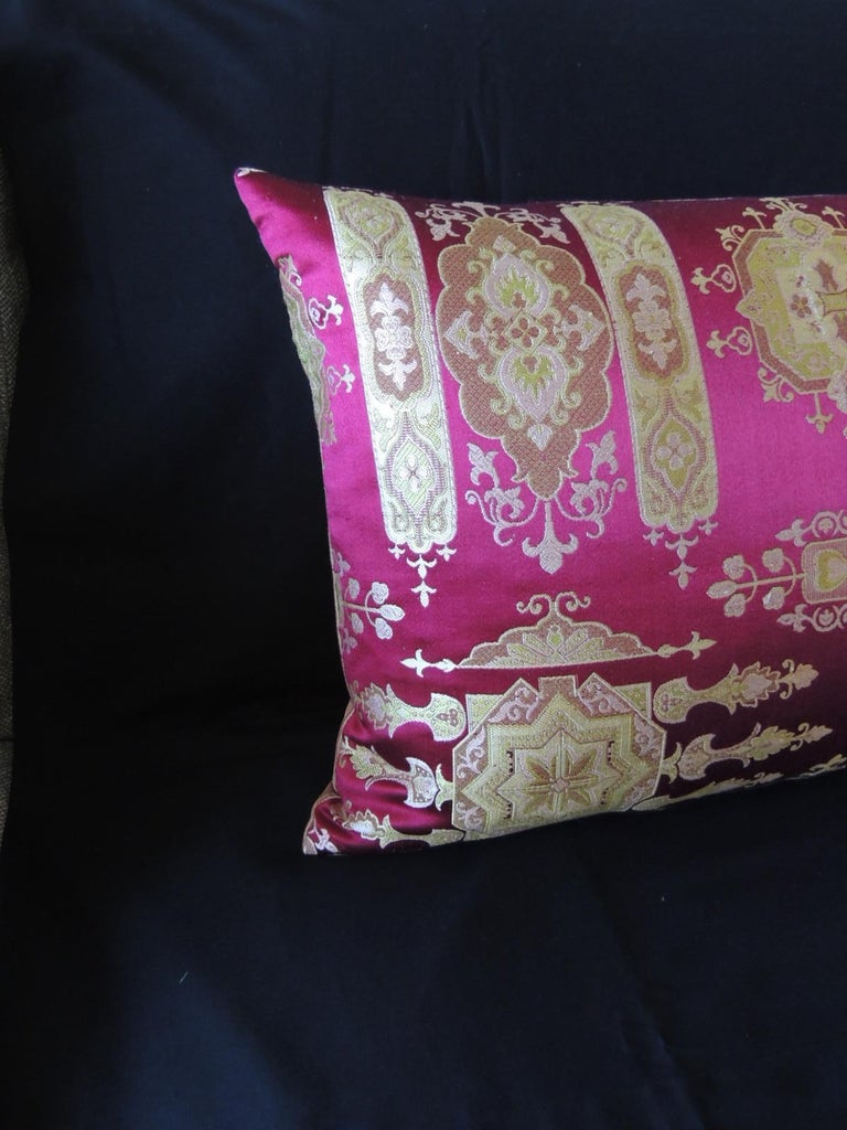 Vintage scarlet red and gold silk brocade bolster decorative pillow.. Gold and celery green woven silk and golden strike silk backing. Decorative pillow handcrafted and designed in the USA. Closure by stitch (no zipper closure) with custom-made
