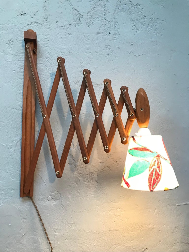 Iconic Vintage Le Klint scissor lamp down light in teak from the 1960s and designed by Erik Hansen. In great vintage condition with new wiring and ready to use. Fitted with a new lampshade in the manner of Josef Frank. Danish design and quality