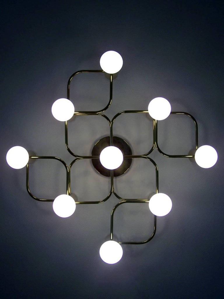 Large sculptural Sciolari style ceiling or wall flush mount by Leola. Polished brass version. Germany, 1960s.