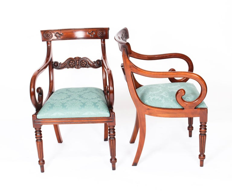 An absolutely fantastic Vintage set of twelve Regency Revival Bar Back dining chairs dating from the late 20th century.  Masterfully hand crafted in beautiful solid flame mahogany,the finish and attention to detail on display are truly