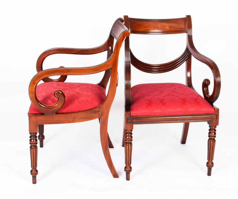 A delightful vintage set of fourteen superb swag back dining chairs, dating from the second half of the 20th Century.  Masterfully crafted in beautiful solid mahogany throughout, the finish and attention to detail on display are truly