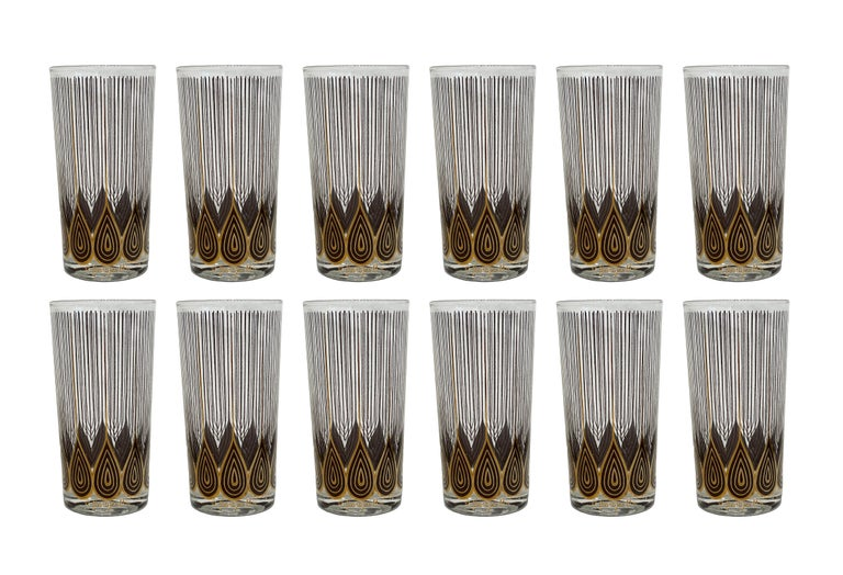 Vintage set of four highball glasses designed by Georges Briard. Mid-Century Modern highball glasses barware This Mid-Century Modern set of 12 Georges Briard cocktail glasses barware are a pattern of applied gold painted overlay of linear teardrops.