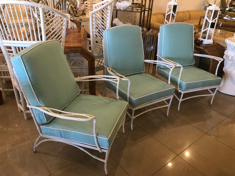 Lovely set of 3 vintage metal, faux bamboo arm chairs, club, lounge for patio, outdoors, sunroom. These have been newly powder-coated in a clean white. All new custom cushions with Sunbrella blue fabric and white trim.  Back of chair height with