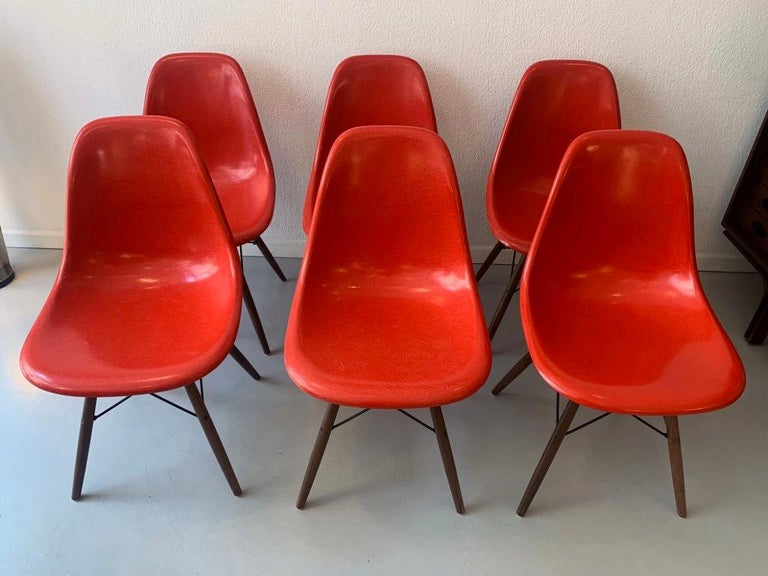 Set of 6 vintage cherry red fiberglass dowel side chairs by Charles & Ray Eames, Vitra ca. 1970's Very good condition, solid walnut new bases.