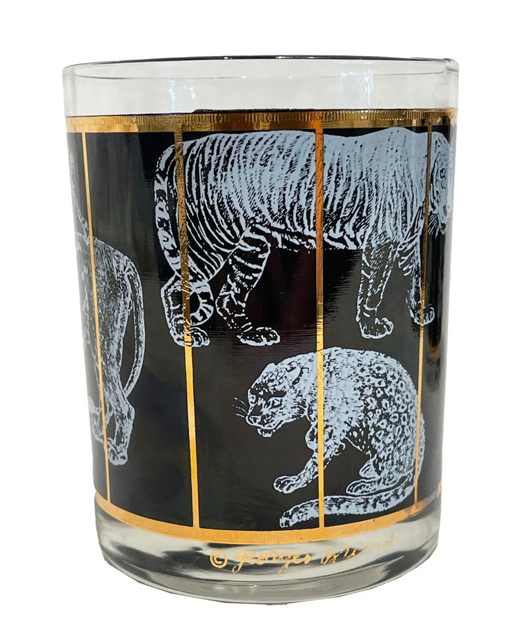 Vintage set of 6 highball glasses designed by Georges Briard. Mid-Century Modern highball glasses barware are amazing in black with gold trim and white jaguars, tigers and more. Very rare and dramatic! Signed by George Briard.