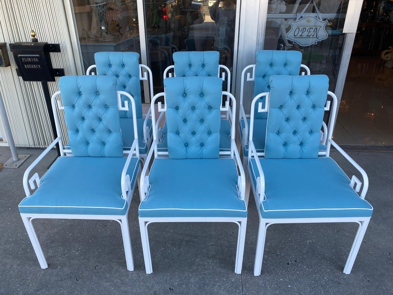 Vintage set of 6 Mastercraft Greek key arm dining chairs. These have been professionally restored from top to bottom. These can be used indoors or on a patio or porch. The set has been professionally powder-coated in a fresh white. The cushions and