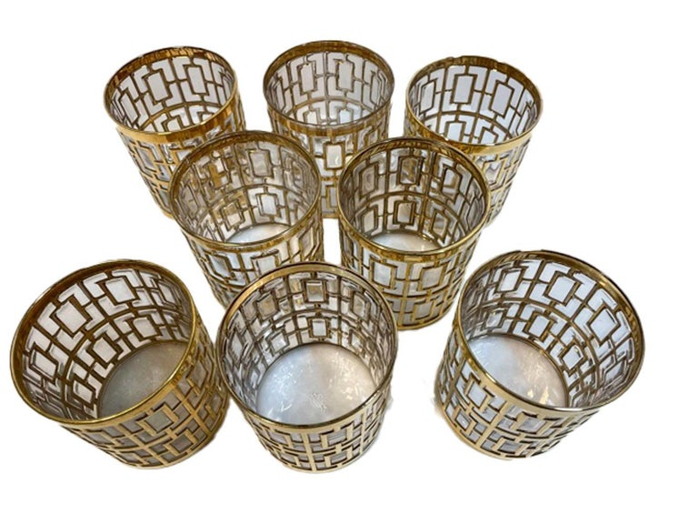 Set of 8 Mid-Century Modern rocks glasses made by Imperial Glass Co. in the Shoji Pattern. Each piece is molded with a raised pattern inspired by Japanese Shoji screens, the raised areas are then gilded in 22k gold.