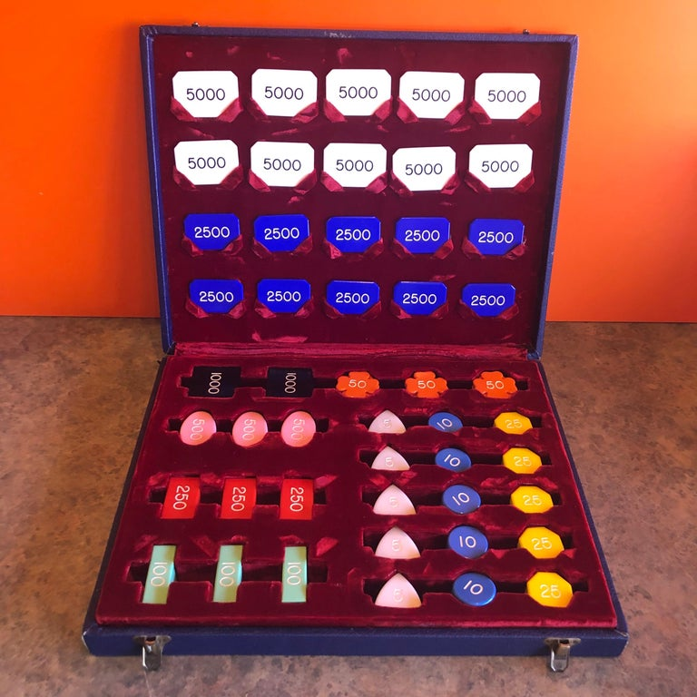 Vintage set of baccarat or poker chips and markers in a blue custom case with red crushed velvet storage departments by Cheney of England, circa 1950s. The set is in very good condition and contains 300 Bakelite