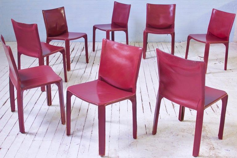 Good-looking and intact original set of vintage 412 cab chairs in Bordeaux leather, designed by Mario Bellini and manufactured by Cassina, Italy, 1977. Perhaps the perfect modern chair, and certainly the first seating design to feature a