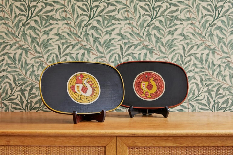Jodi Harada  Japan, 1995   Pair of lacquer trays with chicken design.  Joji Harada was born in Tokyo in 1949. He exhibited his lacquerware yearly in Okinawa. Okinawa has a long tradition of producing and exporting lacquer. In addition to