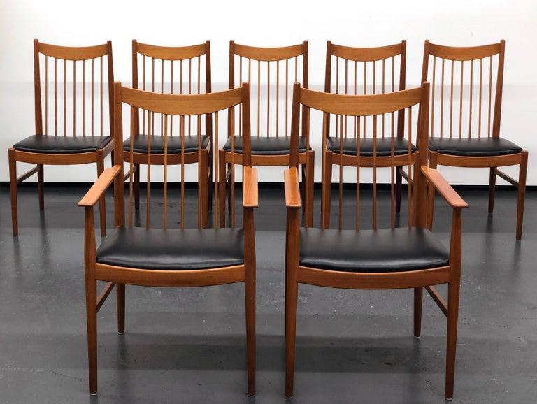 Scandinavian Modern Vintage Set of Seven Teak Spindle Back Dining Chairs by Arne Vodder for Sibast For Sale