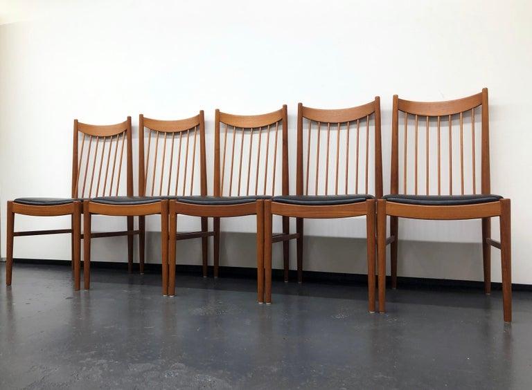 Danish Vintage Set of Seven Teak Spindle Back Dining Chairs by Arne Vodder for Sibast For Sale