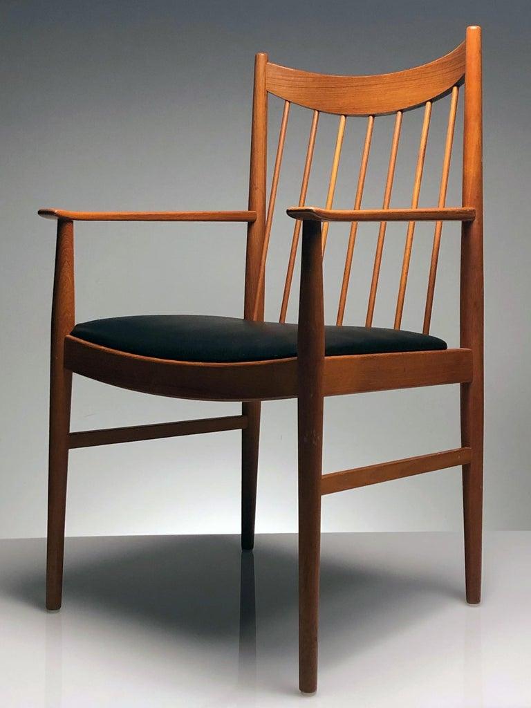Wood Danish Modern Set of Six Plus One Teak Spindle Back Dining Chairs  Arne Vodder  For Sale
