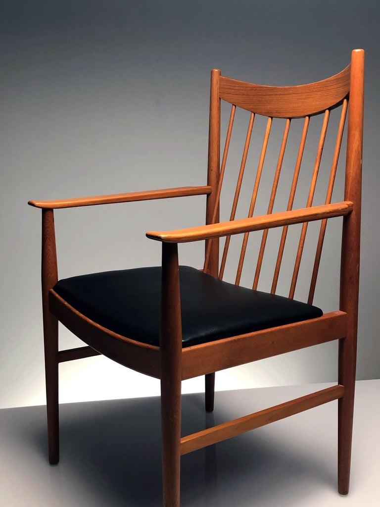 Wood Vintage Set of Seven Teak Spindle Back Dining Chairs by Arne Vodder for Sibast For Sale