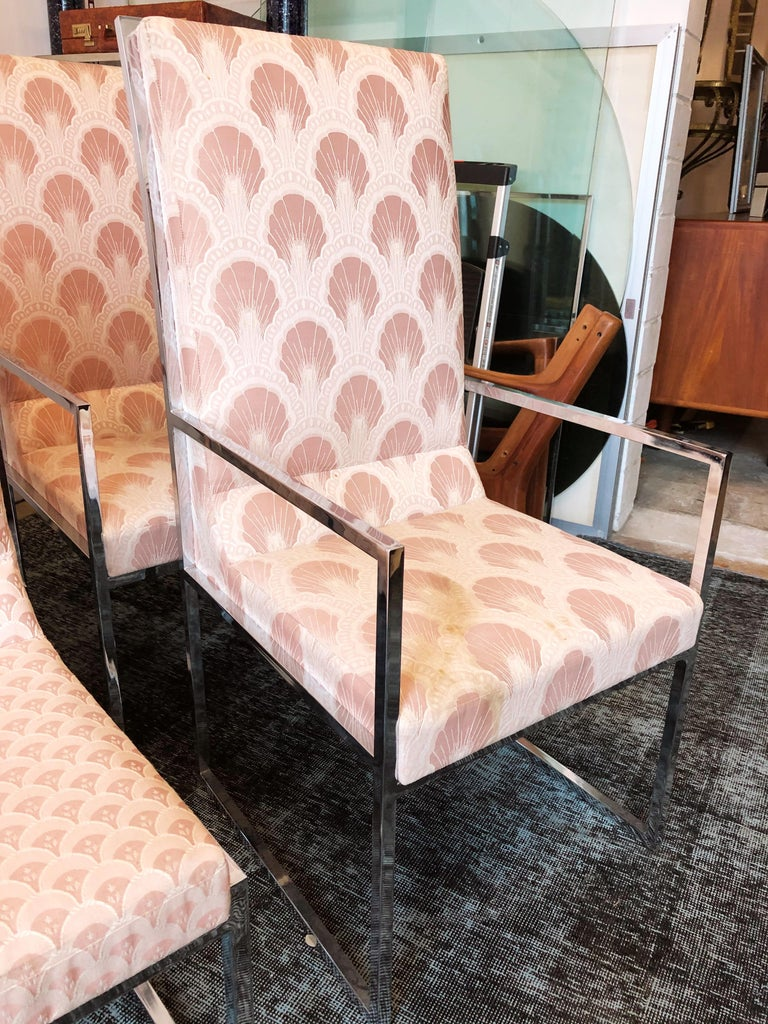 This vintage set of six chrome dining chairs in the manner of Milo Baughman are in overall good condition. Some staining of upholstery. Reupholstery recommended. Chrome frames in excellent condition. Chairs are light. Two arm chairs and four side