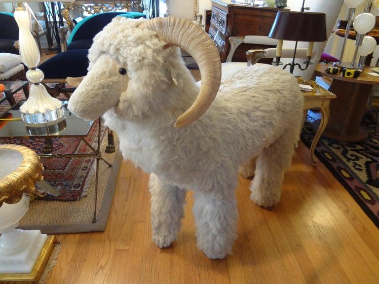Large realistic sheep or lamb sculpture, bench or ottoman made of wood and covered with genuine shearling sheep fur and horns, circa 1967. Dimensions: 36 inches high, 19 inches wide and 39 inches length.