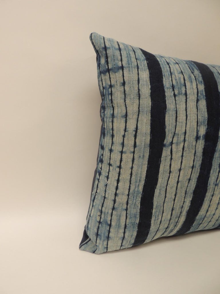 Vintage Shibori stripe blue Asian decorative pillow. Square indigo stripe homespun hemp textile with dark blue linen backing.
