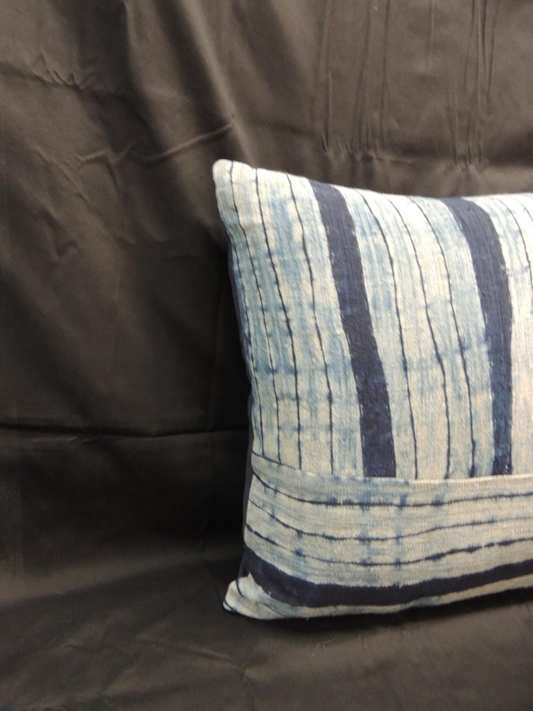 Vintage Shibori stripes blue Asian decorative pillow. Square Indigo stripe homespun hemp textile with dark blue linen backing. Combination of vertical and horizontal stripes to create this unique pattern, Decorative bolster handcrafted and