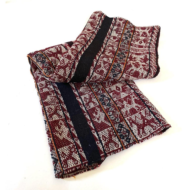 Vintage shoulder cloth (Manta) or carrying cloth(Aguayo) is fromt he Quechua people of the Sacred Valley of the Peruvian Andes in the Cuszo area.   Woven entirely of wool using the warp-faced double-weave technique so that both sides have an