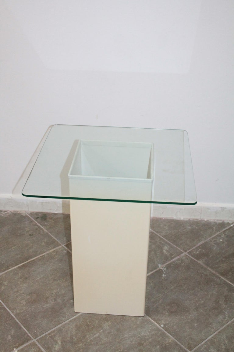 Nice side table in ABS plastic and glass top by Kartell circa 1970.