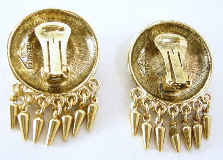 """These beautiful vintage Ben-Amun gold tone dangling clip earrings are stunning.  They have a 3-dimensional swirl design with 7 dangling spikes hanging down.  They measure 1-1/4"""" wide x 1-1/2"""" long.  They are signed """"Ben-Amun"""" and in excellent"""