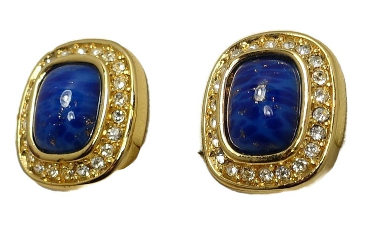 """These vintage signed Christian Dior earrings feature faux lapis center stones with clear crystal accents in a gold tone setting.  In excellent condition, these clip earrings measure 5/8"""" x 1/2"""" and are signed """"Chr. Dior""""."""