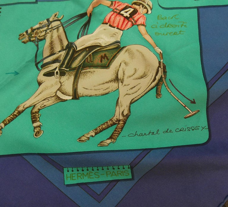 "This vintage signed Hermes scarf features ""Le Monde du Polo"", originally designed by Chantal de Crissey, depicting various notated polo scenes with blue and turquoise background.  In excellent condition, this scarf measures 35"" square and is signed"
