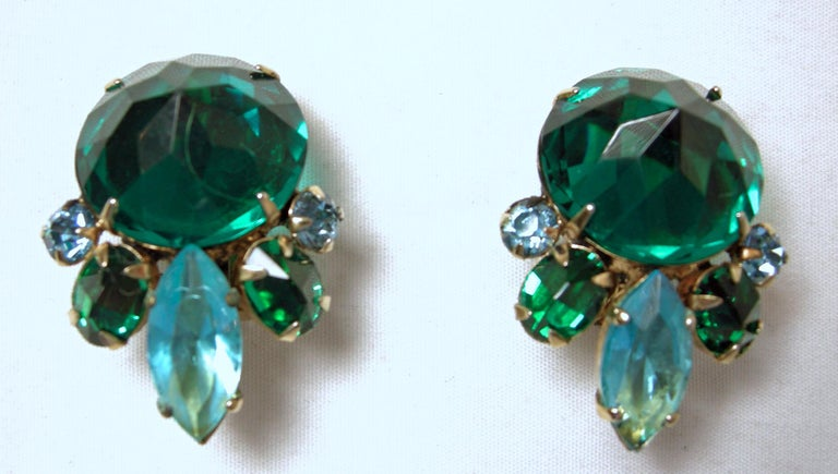"""It's so rare to find a Schreiner set, but here we have a stunning brooch and earrings with green crystals and hues of blue/green crystals in a gold tone setting.  The brooch measures 2-1/2"""" in diameter/across.  The matching clip earrings are 1-1/4"""""""
