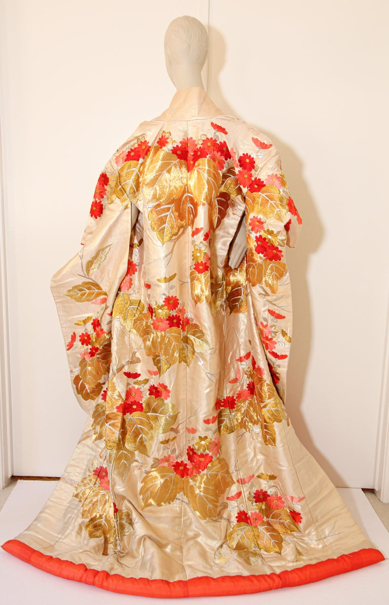 A vintage ivory color silk brocade collectable Japanese ceremonial wedding kimono. One of a kind handcrafted fabulous museum quality ceremonial piece in pure silk with intricate detailed hand-embroidery throughout accented with floral gold and