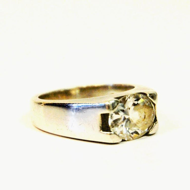 A solid midcentury silvering with a crystal colored oval shaped stone with brilliant cuts. Modernism. Marked with: 925.  Measures: Inner diameter is 17 mm, height of ring 25 mm, thickness 8 mm. Perfect vintage condition.
