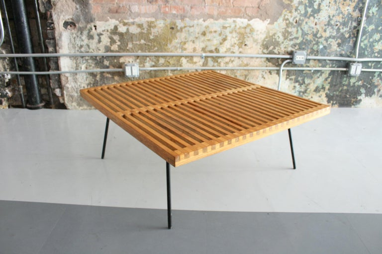 A beautifully crafted vintage table / bench in the Manner of George Nelson or Mel Smilow. Quite possibly a prototype of some sort but, regardless very much in the manner of a California Modern design. The table features stained Oak slats perched
