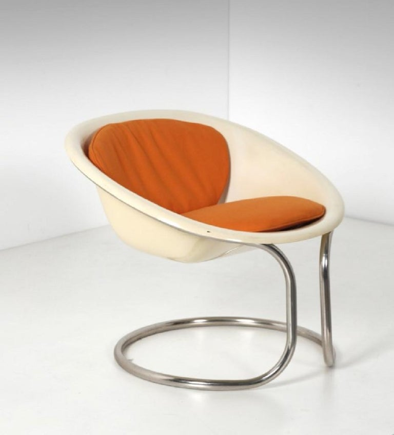 Small fiberglass armchair is an original design work realized in the 1970s.  Original metal, fabric and fiberglass.  Made in Italy.  Total dimensions: cm 73 x 63 x 75.  Very good conditions.