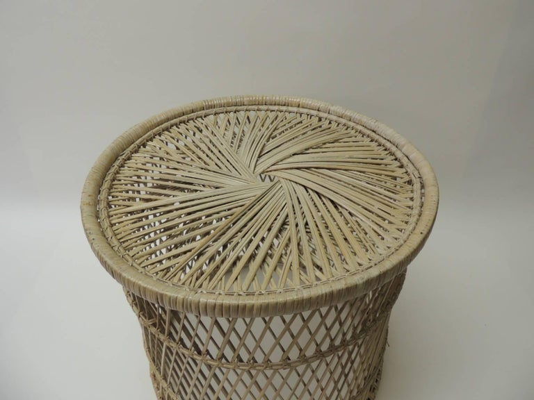 """Vintage small round rattan side table Rattan vintage small round side table with intricate woven design different in the top and the sides. Size: 14 D x 14"""" H. Design Tips: If place upside down, they make great planters, magazine holders or waste"""